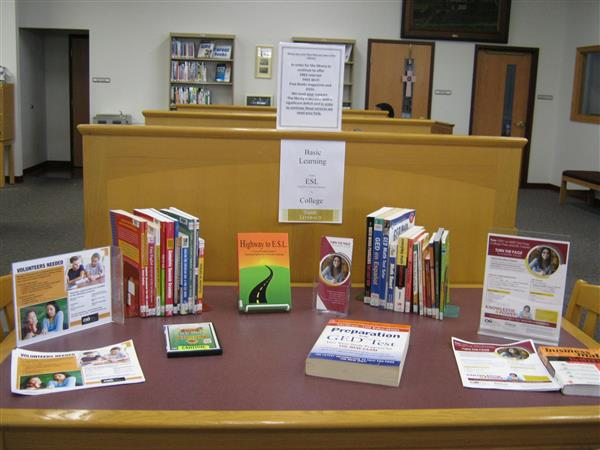 Degenstein Library literacy display table with adult education brochures and flyers