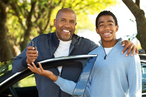 Photo of student driver with teacher/dad