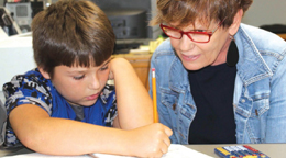 a teacher helping a student with homework