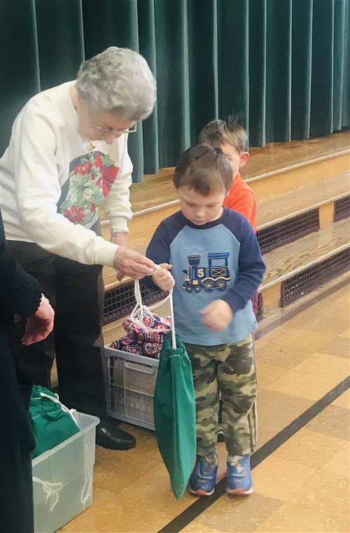 Child receiving gift bag