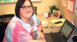 LPN Career Center Instructor, Wendy Nagy, sits at her laptop.